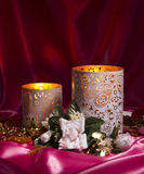 St. Valentine's still life with candles, red and pink satin back Stock Photography
