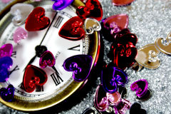 St-Valentine's time. St-Valentine hearts with a old clock Stock Photo