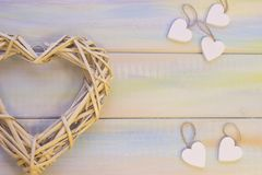 St. Valentine's wooden background with woven heart stock photo