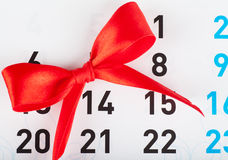 St Valentines day. Sheet of wall calendar with red bow on Valentines day Royalty Free Stock Photos