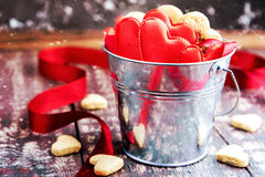St Valentines day concept. Cookies in shape of hearts Red ribbon Wooden background Stock Image