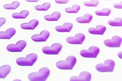 St Valentines day festive background. Purple silk hearts on the white wooden background. St Valentines day background. Purple hearts on the white wooden Stock Image