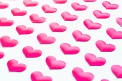 St Valentines day festive background. Red silk hearts on the white wooden background. St Valentines day background. Pink hearts on the white wooden background Royalty Free Stock Images