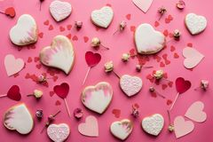 st valentines day flat lay with glazed heart shaped cookies stock photos