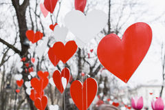 St. Valentines decorations in the park. Red and white hand made hearts Royalty Free Stock Photography