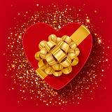 St Valentines heart shaped gift box with gold ribbon. Stock Image