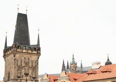 St. Vithus Cathedral. On Prague castle seen over old red roofs by tower Malostranska mostecka vez in Czech Republic Royalty Free Stock Image