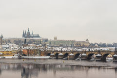 St Vitus Cathedral and Charles Bridge covered in snow Stock Photography