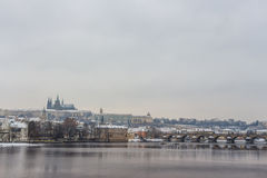 St Vitus Cathedral and Charles Bridge covered in snow Royalty Free Stock Photos