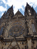 St. Vitus Cathedral. This Gothic cathedral is located within the Prague castle. There is front face with rosette and two towers in the picture Stock Photo