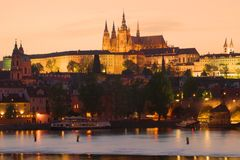 St. Vitus Cathedral in the night illumination against the background of the April sunset. Czech Republic, Prague. St. Vitus Cathedral in the night illumination stock images