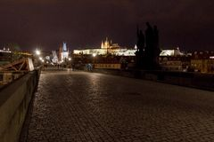St. Vitus Cathedral and Prague Castle with Charles Bridge at night, Prague, Czech Republic. Stock Images