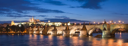 St Vitus Cathedral, Prague Castle and Charles Bridge. Pretty night time illuminations of Prague Castle, Charles Bridge and St Vitus Cathedral reflected in the stock images