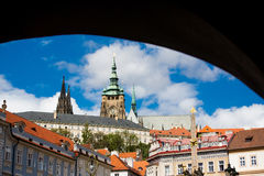 St. Vitus cathedral seen from under an arch in Lesser Town Square Royalty Free Stock Photography