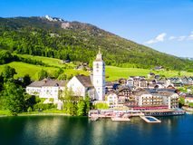 St. Wolfgang aerial view. St. Wolfgang catholic church or Pfarrkirchen Wallfahrtskirche aerial panoramic view in St. Wolfgang im Salzkammergut at Wolfgangsee Royalty Free Stock Image