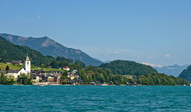 St Wolfgang from the lake. View to St. Wolfgang city and mountains from the Wolfgangsee lake Stock Photo