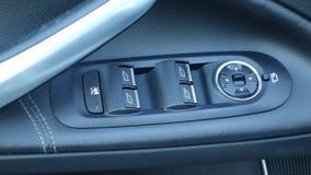 Stać na czele zamkniętych samochodowych okno i popiera elektrycznych okno niskich lub Titanium pakunek, rzemienny tapicerowanie,  obraz stock