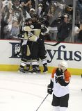 Staal. Penguins Jordan Staal  is mobbed by teammates after scoring in the second period of May 18,2008  game 5 at Pittsburgh. Flyers Scottie Upshall skates back Stock Images