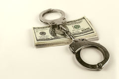 Staalhandcuffs en dollars Royalty-vrije Stock Foto