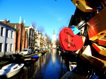 Love locks on a bridge in Amsterdam royalty free stock photo