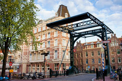 Staalstraat Bridge on Kloveniersburgwal Canal in Amsterdam Royalty Free Stock Images
