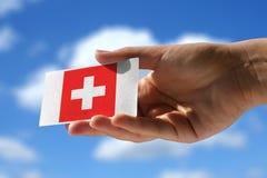 Staatsflagge von der Schweiz über Visitenkarte Lizenzfreie Stockfotos