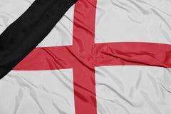 Staatsflagge von England mit schwarzem Trauerband Lizenzfreie Stockfotos
