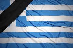 Staatsflagge von Griechenland mit schwarzem Trauerband Lizenzfreie Stockfotografie