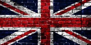 Staatsflagge von Großbritannien auf einem Ziegelsteinhintergrund stockfotografie