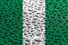 Staatsflagge von Nigeria machte von den Wassertropfen Hintergrundprognosenkonzept lizenzfreies stockfoto