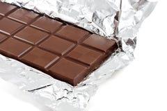 Stab der Milchschokolade in der Folie Stockbild