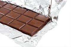 Stab der Milchschokolade in der Folie Lizenzfreies Stockbild