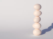 Stability eggs construction in sunrays Stock Photos