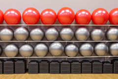 Stability exercise balls in gym. Silver and red exercise balls as seen in a club or gym Stock Images