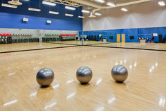 Stability exercise balls in gym. Silver exercise balls as seen in a club or gym Royalty Free Stock Images