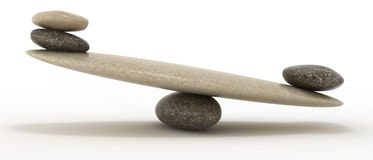 Stability scales with large and small stones Stock Photo