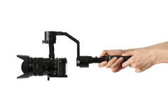 Stabilization System with 3-axis gimbals & Mirrorless Camera. 3-axis gimbals Stabilization System with Mirrorless Camera. Using this equipment, a Videographer Royalty Free Stock Images