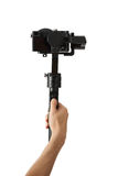 Stabilization System with 3-axis gimbals & Mirrorless Camera. 3-axis gimbals Stabilization System with Mirrorless Camera. Using this equipment, a Videographer Royalty Free Stock Image