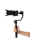 Stabilization System with 3-axis gimbals & Mirrorless Camera. 3-axis gimbals Stabilization System with Mirrorless Camera. Using this equipment, a Videographer Stock Image