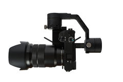 Stabilization System with 3-axis gimbals & Mirrorless Camera. 3-axis gimbals Stabilization System with Mirrorless Camera. Using this equipment, a Videographer Stock Images