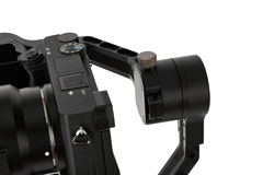 Stabilization System with 3-axis gimbals & Mirrorless Camera. 3-axis gimbals Stabilization System with Mirrorless Camera. Using this equipment, a Videographer Stock Photo