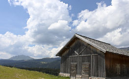 The stable. A beautiful stable in mountain during a summer sunny day Stock Photos