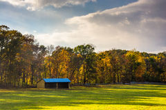 Stable and autumn colors in rural York County, Pennsylvania. Royalty Free Stock Photography