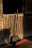 Stable door with brush,rake and scoop Stock Images