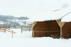 Stable for horses in winter. Stable for horses with a lot of snow in winter Royalty Free Stock Image