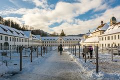 Stables next to Einsiedeln monastery in Switzerland. EINSIEDELN, SWITZERLAND - JANUARY 2016 - People walking through stables next to Einsiedeln monastery in Stock Photography