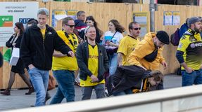 STACHUS, MUENCHEN, APRIL 6, 2019: bvb fans on the way to the soccer game fc bayern munich vs borussia dortmund stock photo