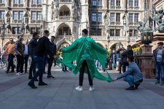 STACHUS, MUENCHEN, APRIL 6, 2019: soccer fans are shooting a ball to a man wearing a shirt with the shape of a soccer goal royalty free stock photos