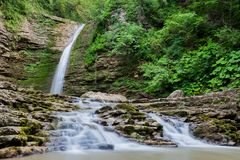 A waterfall among the mountains. mountain river. wild forest Royalty Free Stock Photography