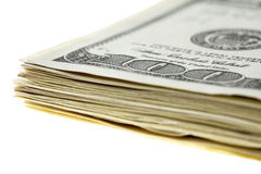 Stack of $100 bills. Stack of one hundred dollar bills on white Royalty Free Stock Photos